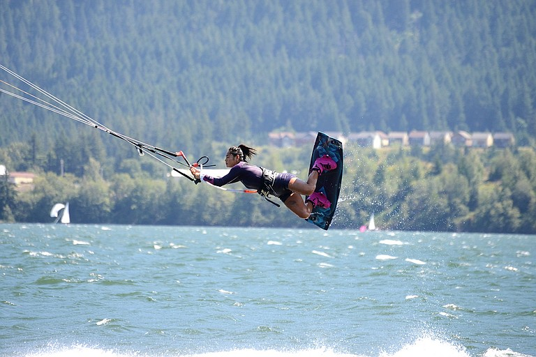 THE BRIDGE OF THE GODS KITE FEST featured more competitors than ever at the 16th annual event held last weekend, that featured a pro competition, an amateur competition, and a downwinder race. Above, Min Kim, of Vancouver, B.C., launches herself out of the water. Look for more photos of Friday's competition in a photo gallery that will be posted online Wednesday on the Hood River News website (hoodrivernews.com).