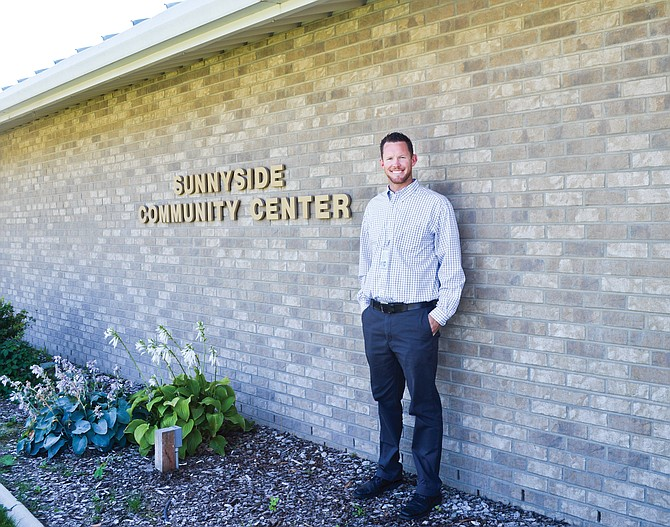 New Parks and Recreation director Lander Grow stands next to the Sunnyside Community Center.