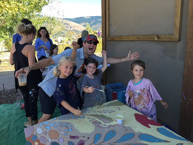 SUPERINTENDENT Dan Goldman hams it up with young mural artists at the 2015 Music Festival of the Gorge at Waterfront Park. See story below for details on the 2016 event.