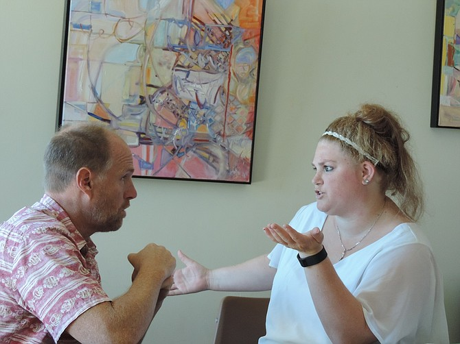 Mayor Paul Blackburn talks with Shallon Courser, Hood River Walmart representative.