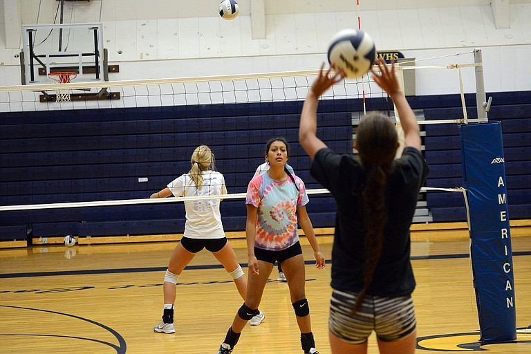 PRACTICES officially began for Hood River Valley High School athletics this week. Above, Bianca Badillo (tie-dye shirt) works on a drill with Hannah McNerney, both members of the HRV varsity volleyball team, Thursday afternoon.