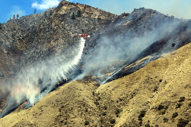 A Skycrane helicopter water dump pictured last Thursday, Aug. 18, on the Gun Club Fire at Riggins.
