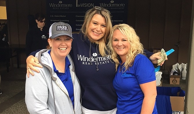 WINDERMERE's Kim Barnes, The Dalles office manager, left, poses with Owner Kim Salvesen-Pauly and Hood River Office Manager Angie Greenwood before the start of the golf tournament.