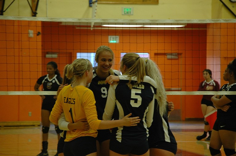 Rebecca Johnston (1), Katie Kennedy (9) and Emily Curtis (5) talk during a timeout.