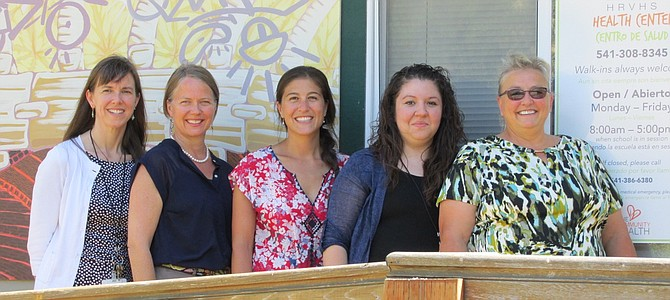 The School-Based Health Center (SBHC) team (left to right) Lynne Frost, SBHC administrator and medical director; Heather Nielsen, licensed professional counselor; Sarah Dang, family nurse practitioner; Christina Ayala, team assistant; and Melody Farrell, certified medical assistant.