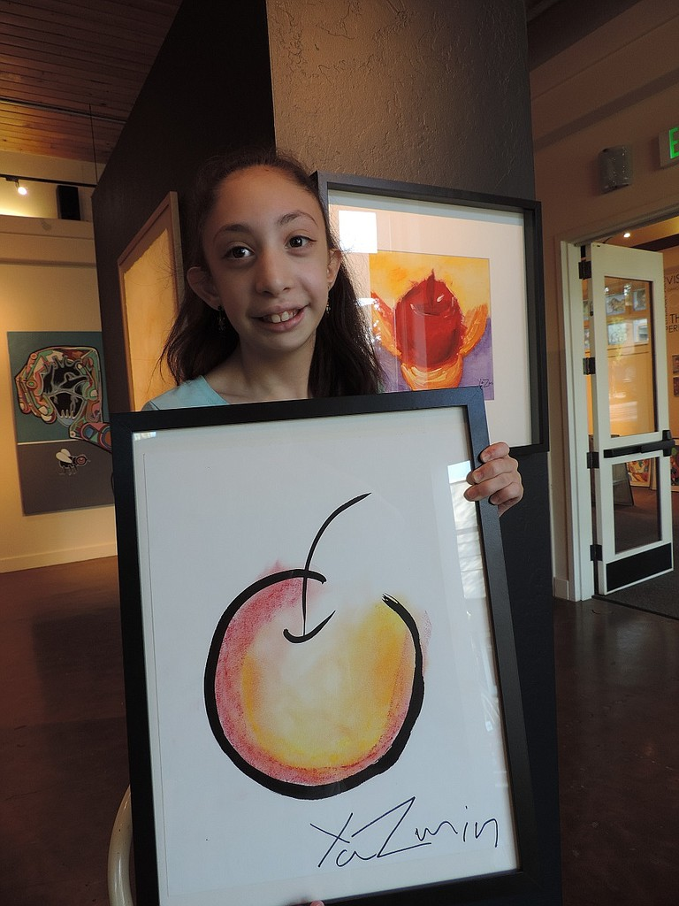 """Yazmin Villegas with two of her works in """"Emerging Artists."""""""