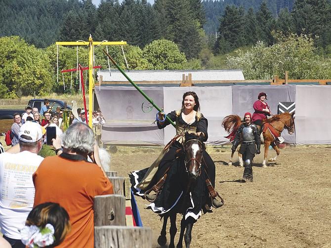 Epona performers re-enact a jousting tournament at Shrewsbury Renaissance Faire.