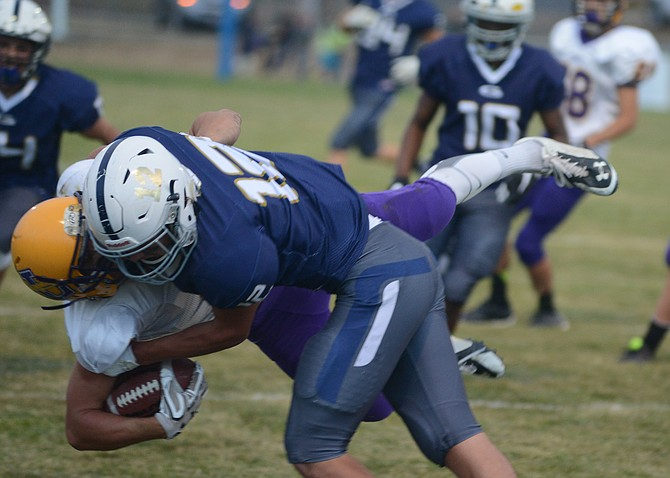 As pictured, Grangeville's Luke Stokes unloaded on  Lewiston JV running backs, but he also made his mark on the scoreboard with three rushing touchdowns.