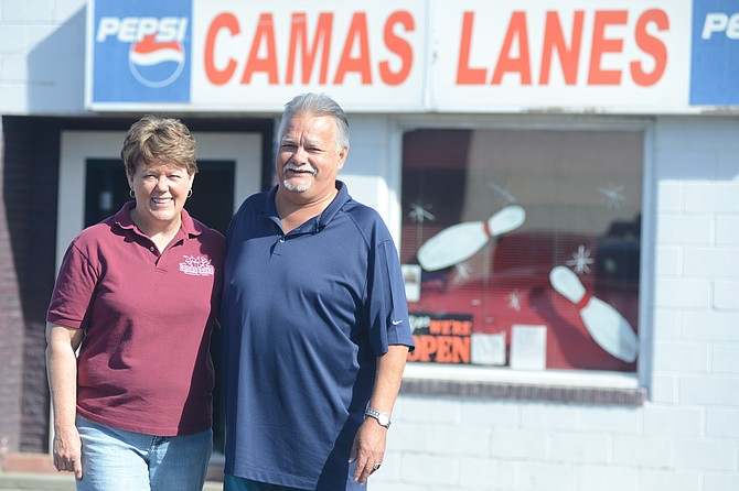 Louie Serrano (right) bowled his 16th perfect game Sept. 8 at Camas Lanes, where to the best of the owner-operators' knowledge, it was the first 300 game in facility history. Representing the bowling alley in the photo is Brenda McRoberts, who runs Camas Lanes with her husband, Doug McRoberts.