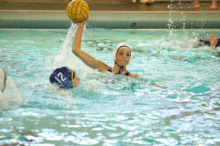 HRV GIRLS WATER POLO had a big win on Thursday over Barlow, defeating the 6A water polo powerhouse for the first time in the history of the Eagles' girls program. Above, frosh Faith Ocheskey, one of the key additions to an already talented roster, winds during the game against Barlow. Ocheskey led the team in scoring with three goals.