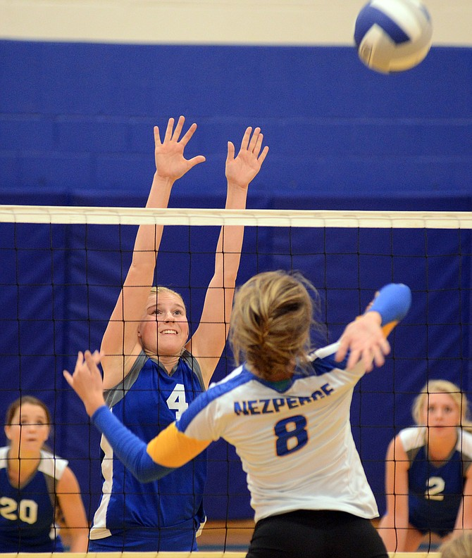 Salmon River senior Sarah Laritz (4) went up strong and made the block against Nezperce sophomore Hannah Stapleton during the Savages straight-sets win Saturday.