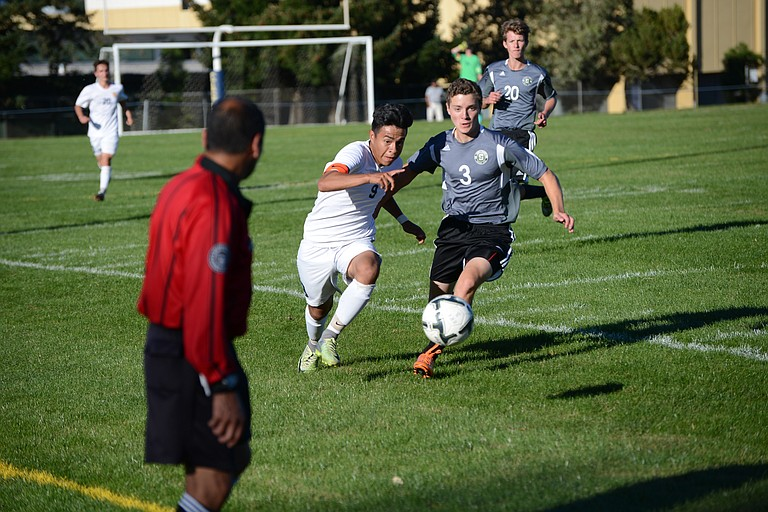 5A FINALS REMATCHES against Summit (2013) and Wilsonville (2015) both went HRV's way this week, with the Eagles defeating Summit 2-1 and Wilsonville 5-1. The victory over Summit was the 40th game in a row HRV has gone without a loss. Above, Jorge Campos (white jersey) chases the ball.