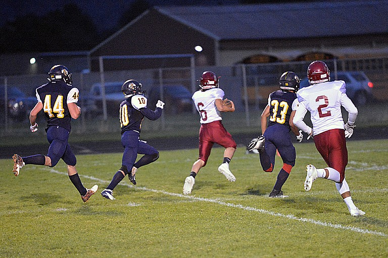 Myron Super, No. 6 of Okanogan, finishes off a 35-yard touchdown run at Oroville on Friday. The Bulldogs went on to win the game between undefeated teams, 53-14.