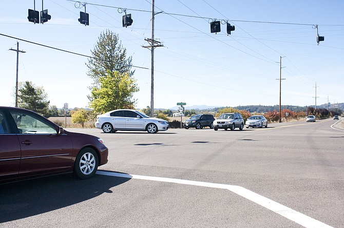 Drivers negotiate crossing and turning at the intersection of Clow Corner and Highway 99 on Sunday afternoon.