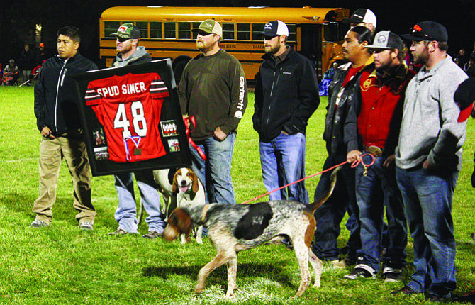 A group of former Dufur Rangers football players from the high school's 2006 championship team gathered on the field at halftime Friday night to honor their former teammate, Spud Simer, who died tragically in a farming accident in July. The Ranger football program retired Simer's No. 48 jersey.                                                                       Jesse Burkhardt photo