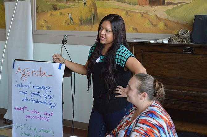 Brenda Orozco, client coordinator, and MariRuth Petzing, lead attorney, answer audience questions at a recent open house to introduce the new Immigration Counseling Services staff to community members in health, nonprofit and social services fields.