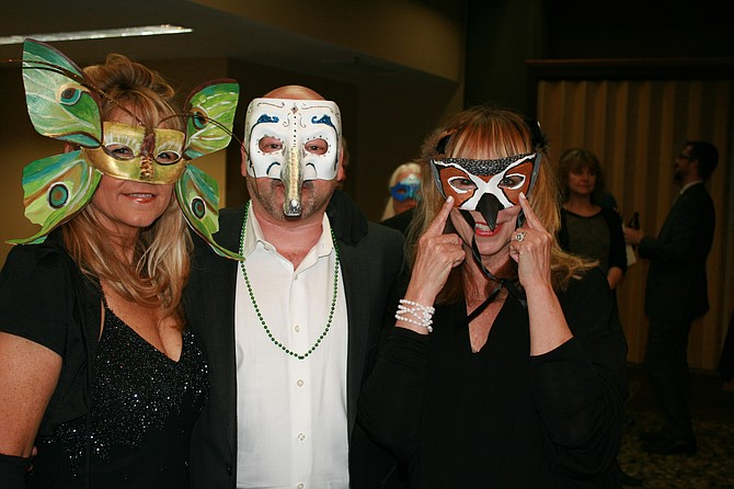 EMCEE Barb Ayers, at left in top photo, with Dave and Sunny Simon, model their masks. The Masquerade Ball, at Best Western Plus Hood River Inn, was just the start of the 2016 Columbia Gorge United Way. For information about getting involved in the campaign, call coordinator Ali Church at 541-386-6100.