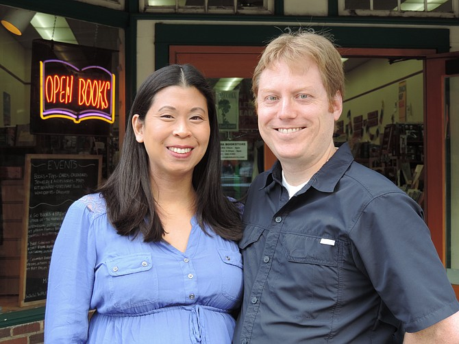 Jenny and Muir Cohen in front of their store.