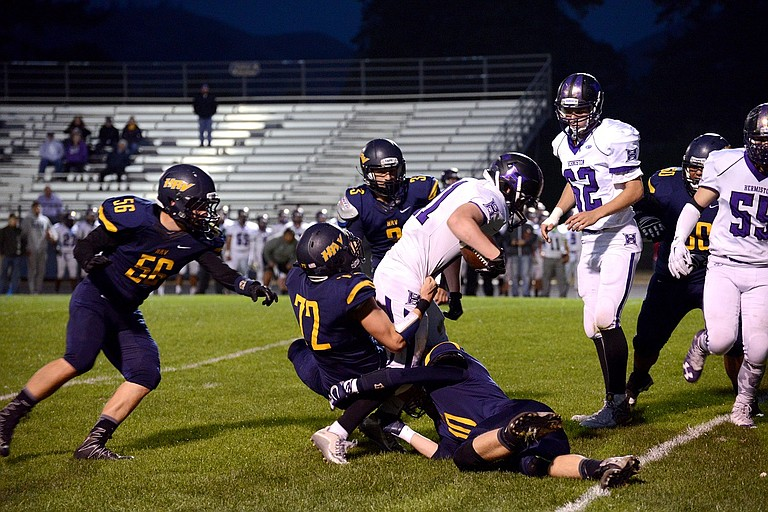 ANDREW RINELLA (No. 72) makes a tackle during Friday's game with Hermiston.