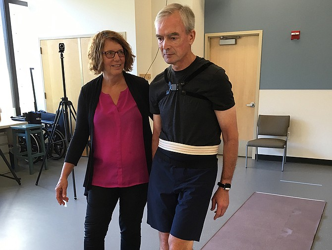 Dr. Fay Horak (left) helps balance lab study participant Peter Miller, through an exercise.