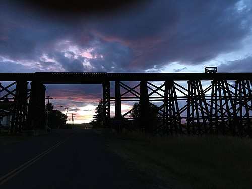 The silhouette of the Camas Prairie Railroad train trestle located in Cottonwood at dusk.