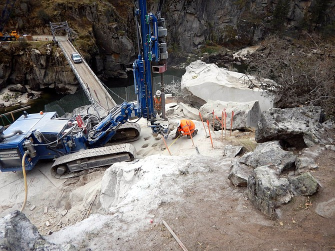 At the north anchorage from which the new Manning Crevice Bridge will be strung, RSCIcrewmen have been drilling relief holes in the anchorage pit before using the excavator with the rock breaker attachment to remove an obstructing boulder.
