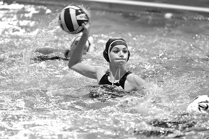FRESHMAN Faith Ochesky takes aim for one of her three goals Thursday against Sandy at the Hood River Aquatic Center. She added five steals to her stat list.