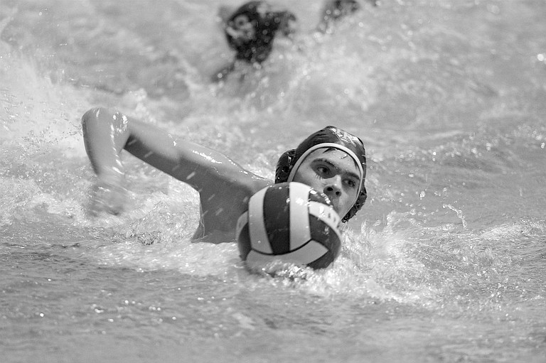 WILL SUMMERFIELD corrals a position and moves toward the goal in Thursday's win over Sandy at Hood River Aquatic Center.