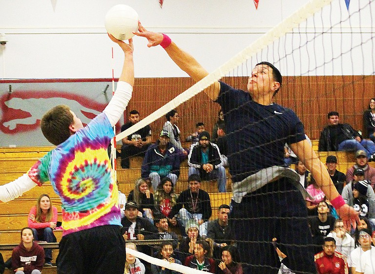Junior Gabriel Esqueda, right, reaches over the net to block a tip by freshman Rocko Parrish during last night's inter-class volleyball matchup.