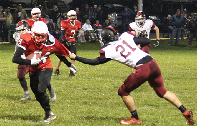 Dufur senior Kolbe Bales, on left, shrugs off the tackle of Ione's Austin Carter in Friday's 1A football contest played at Dufur High School. Dufur won, 62-0. Seniors Bailey Keever, Travis Lucas, Bales, Josh Brown, Cole Morrison, Ben Anderson and TJ Kennedy were honored before the game for their years of dedication to the program.