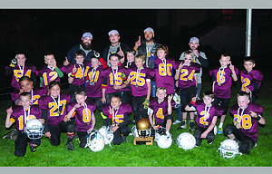 The Dalles third and fourth grade Maroon football team celebrates its second consecutive youth football championship Saturday at Columbia High School in White Salmon. TD led 18-8 at the half and 18-16 with less than eight minutes left in the fourth quarter, but then added a 30-yard touchdown run by Nolan Cates with 3:26 left in regulation. TD linebacker Jonah Ofisa made the final tackle to give his team the 24-16 victory.                                                                   Ray Rodriguez photo