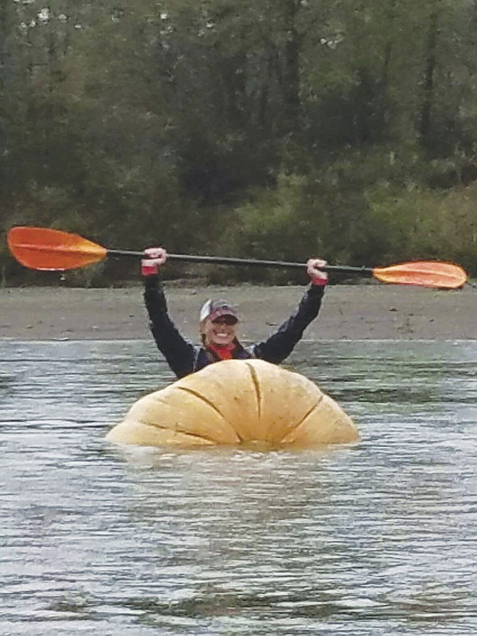 Charity Rusch Marshall paddled a pumpkin 15 miles.