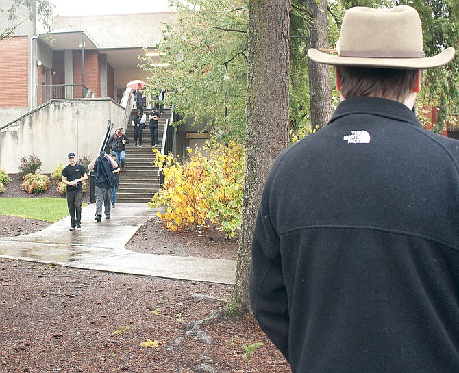 Western Oregon University employees walk to a designated gathering area during the Great Shakeout on Thursday, part of a nationwide earthquake preparedness drill.