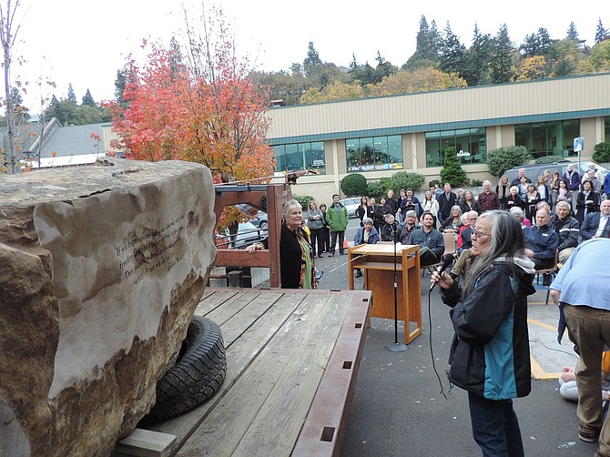 LAURIE Yasui, Min's daughter, reads the inscription during the Oct. 19 Legacy Stone dedication at Hood River Library.