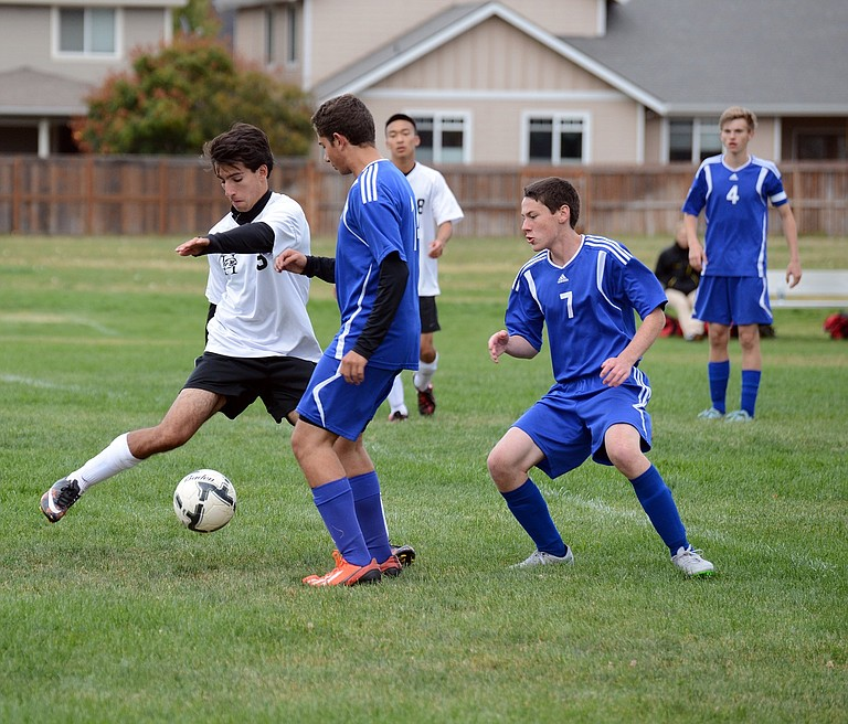 QUINN ROETCISOENDER (white jersey), shown above in a regular season game against North Clackamas, scored four goals against the Saints in Horizon's semifinal loss Monday.