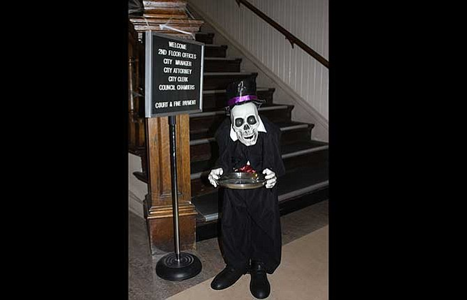 Visitors to The Dalles City Hall are welcomed in the lobby by a ghoulish figure holding a silver platter. The downtown area will again host trick-or-treaters on Halloween.