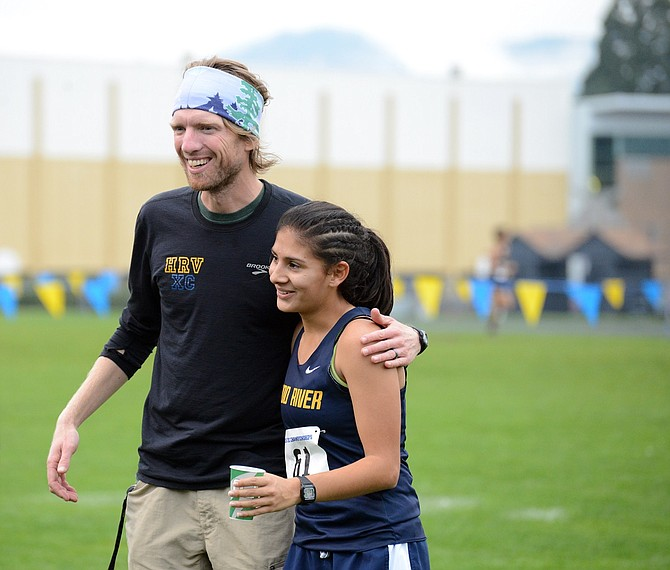 HRV XC HEAD COACH Brandon Bertram embraces Evelyn Nuñez after the girls race. Nuñez, a sophomore, finished fourth overall and had a big improvement over the last time she ran the HRV home course at the Skip Sparks Invite last month.