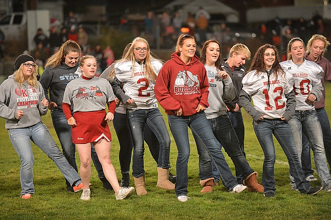Okanogan High School seniors dance at halftime of the Backyard Brawl against Omak on Friday in Okanogan.