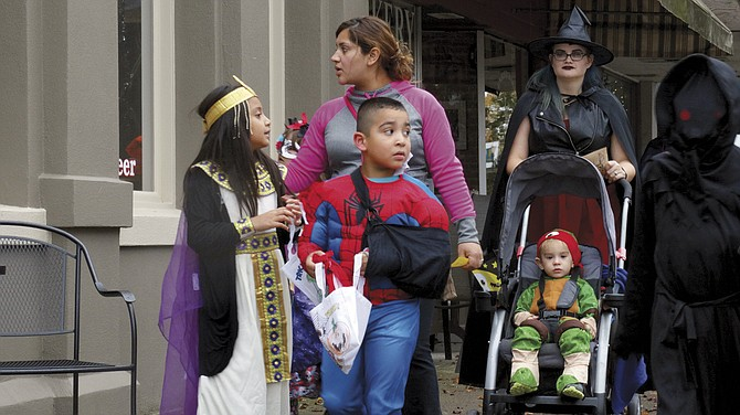 Hundreds of children and their parents flooded the streets of downtown Independence on Monday for the annual trick-or-treat, sponsored by the Independence Downtown Association. Businesses kept their doors open Monday afternoon to accommodate the hordes of costumed youths seeking candy.