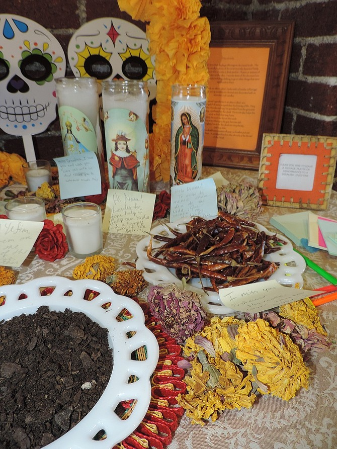 DIA de Los Muertos is also observed in library lane, ground floor of Hood River Library, with flowers, peppers, candles and other symbols, and paper and pens to write messages to loved ones.