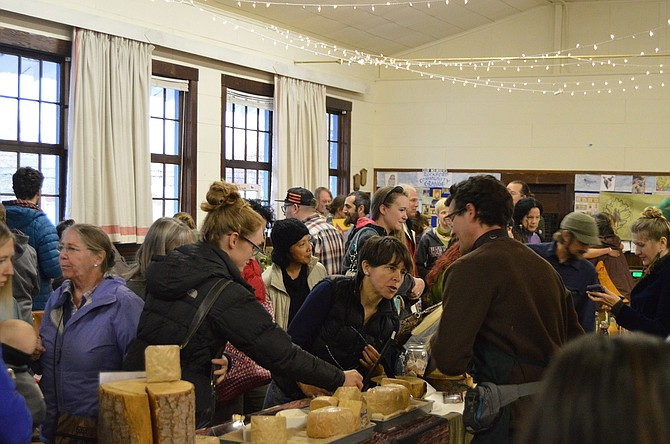 Patrons pack the upper hall at Rockford Grange for a wide variety of goods, ranging from produce to tea to cheese to meat, at Saturday's second annual Fill Your Pantry event.