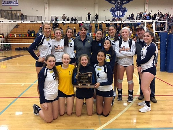 THE HRV VOLLEYBALL TEAM poses with their sixth-place state tournament trophy Saturday at Liberty High School.