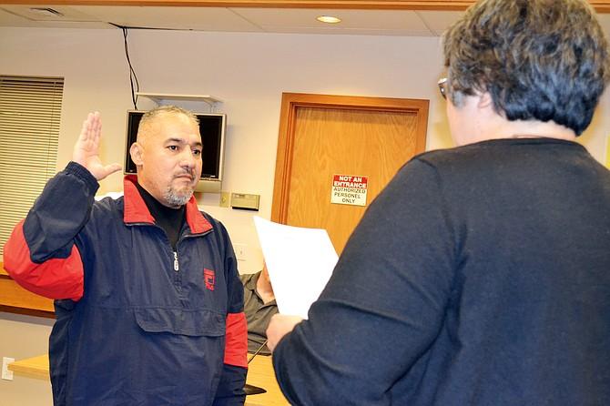 City Clerk/Treasurer Alice Koerner administers the oath of office to new mayor Jose Trevino.