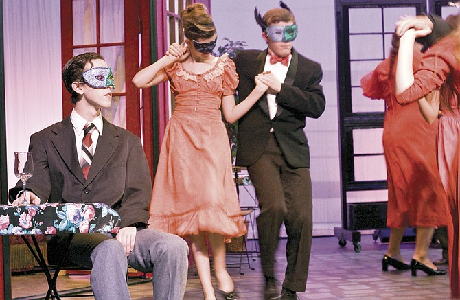 """Revelers drink and dance during a scene in Dallas High School's production of """"Much Ado About Nothing,"""" running Thursday through Saturday."""