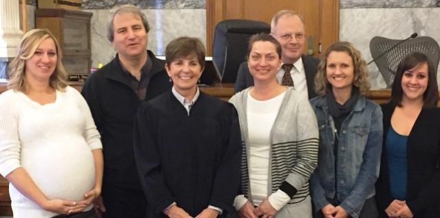ADVOCATES Tonya Flory, left, Guy Tauscher, Honorable Janet L. Stauffer, Owen Lamp, Karen Lamp, Krista Shilvock and Maresa Roberts on Oct. 20 — the day the new CASA volunteers were sworn in.