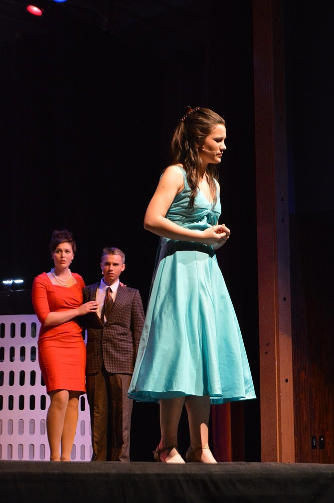 """In this scene from """"Catch Me If You Can,"""" Brenda (JoJo Summersett) comes to grips with Frank Jr.'s identity (Sean Gray, not pictured) while parents Carol (Ann Maria Goodman) and Roger (Nathan Daniel) look on."""