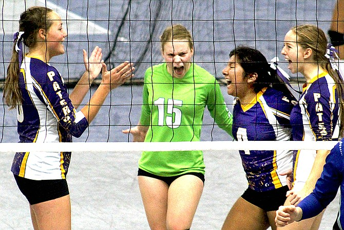 Pateros High School volleyball players celebrate at state 1B tournament Friday at the Yakima SunDome.