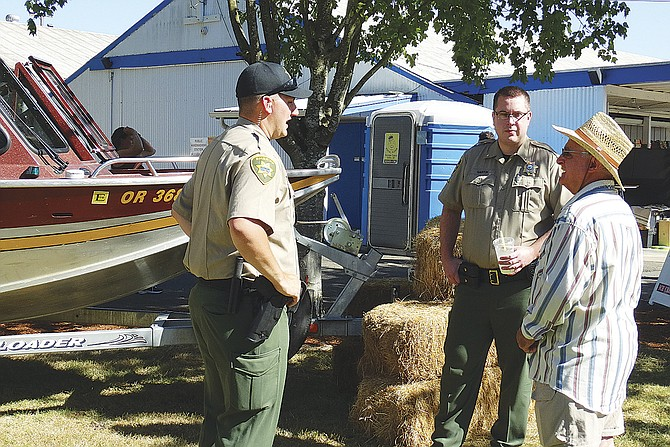 Sheriff Mark Garton, center, talks with a visitor at the Polk County Fair in August. Garton won his first election for the office by a wide margin on Nov. 8.