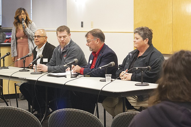 Western Oregon University held a forum on Friday that included university president Rex Fuller, second from right, to quell fears after the election on Nov. 8.