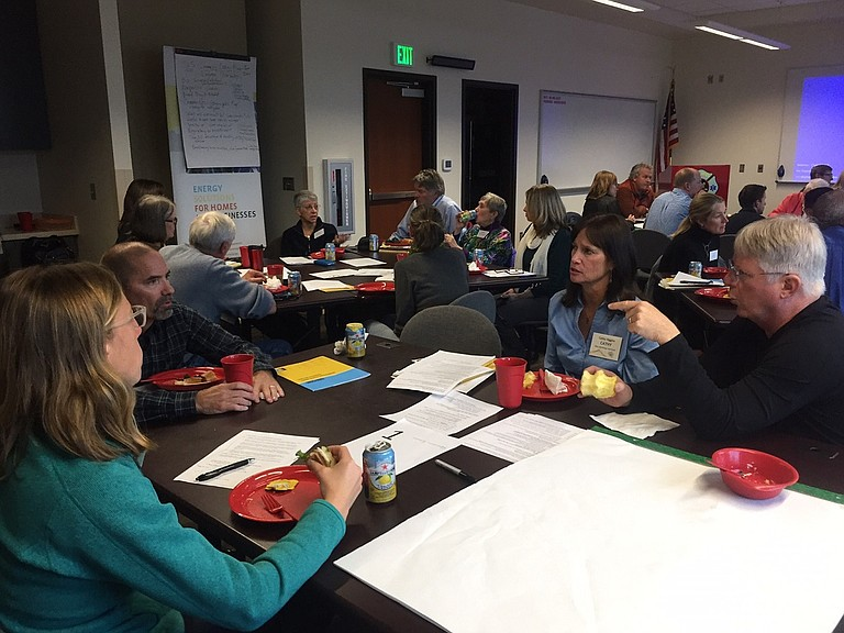ATTENDEES converse over lunch at an energy workshop Nov. 2. The event drew more than 50 people to discuss ways the county can move forward with clean and sustainable energy programs.